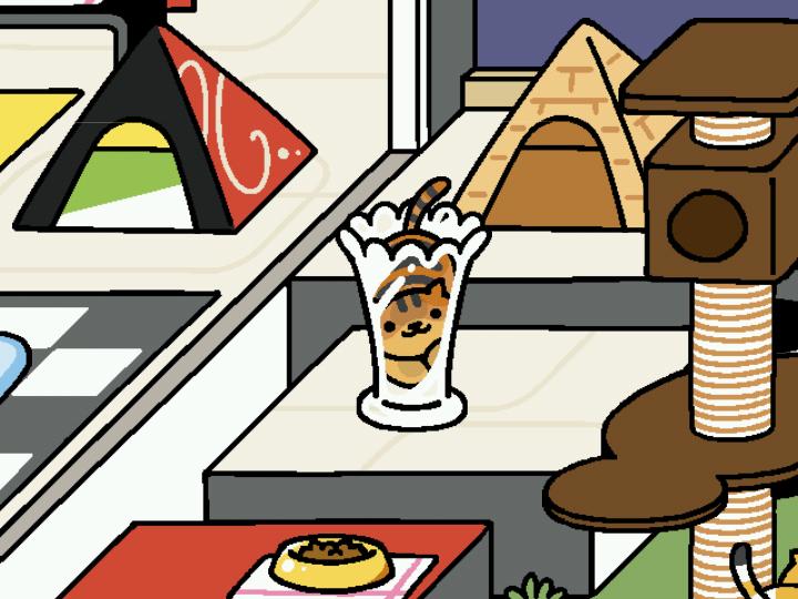 ガラス花瓶に入る猫