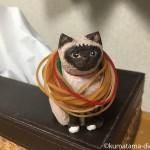 輪ゴムかけにぴったりな木彫りの猫